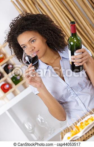 inhaling the wine's aroma - csp44053517