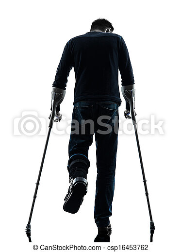 injured man walking with crutches silhouette rear view  - csp16453762