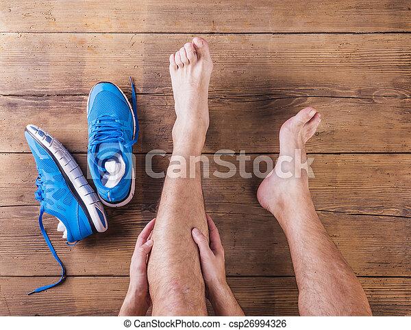 Injured runner - csp26994326