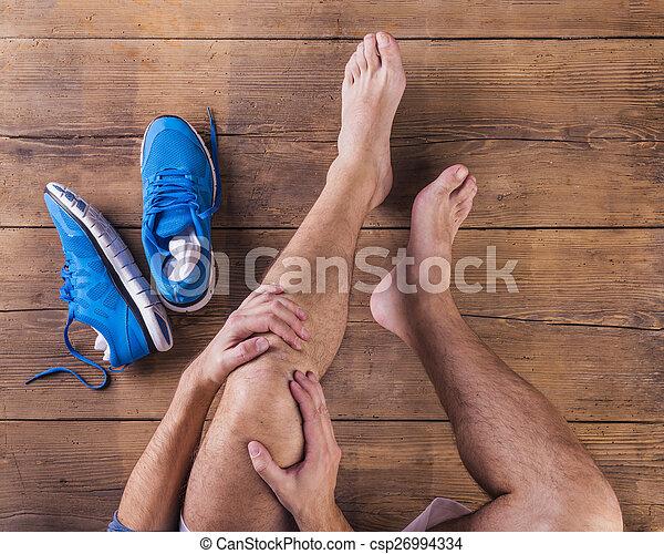 Injured runner - csp26994334