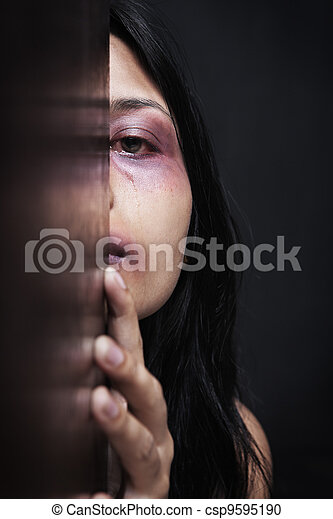 Injured woman hiding in dark - csp9595190