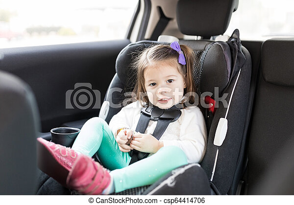 Innocent Child Sitting On Backseat Of Car - csp64414706
