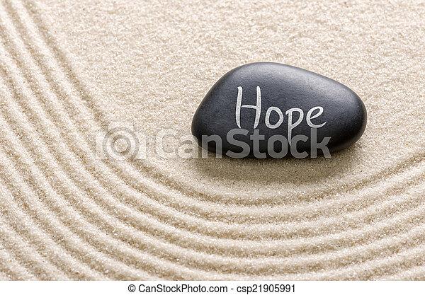 Piedra negra con la inscripción Hope - csp21905991
