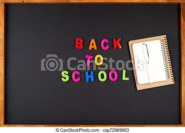 inscription back to school from multi-colored plastic letters - csp72969663