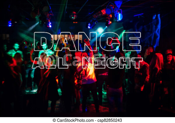 Inscription Dance all night on the background a blurred crowd of dancing people - csp82850243