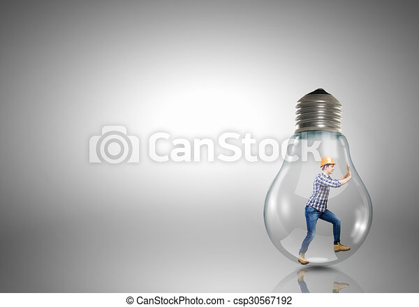inside light bulb builder man inside light bulb trying to get out