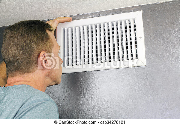 Inspecting a Home Air Vent for Maintenance - csp34278121