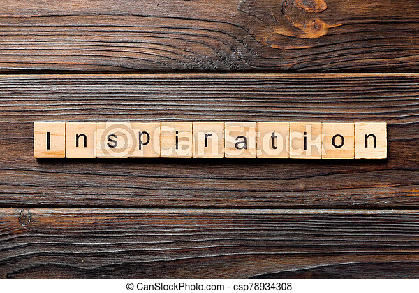 Inspiration word written on wood block. Inspiration text on wooden table for your desing, concept - csp78934308