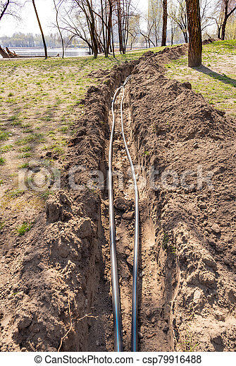 Installation of tubes for an irrigation system - csp79916488
