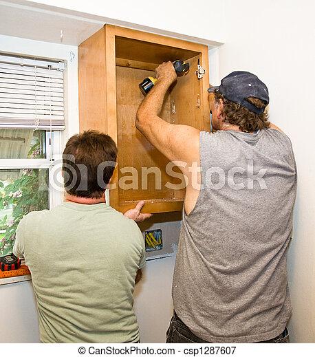 Installing Cabinets - Teamwork - csp1287607