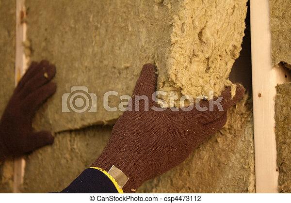 Installing Insulation Closeup - csp4473112