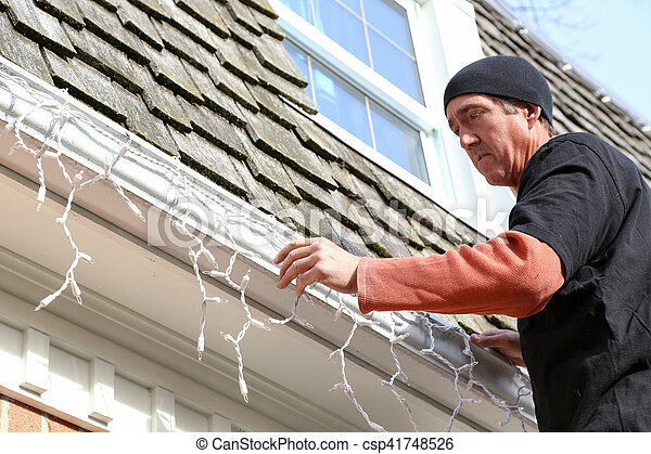 Installing Of The Outside Christmas Lights