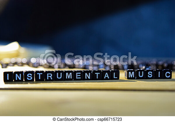 INSTRUMENTAL MUSIC concept wooden blocks on the table. - csp66715723