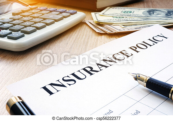 Insurance policy and dollar bills on an office desk. - csp56222377