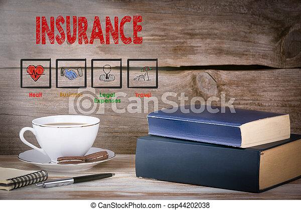 Insurance. Stack of books on wooden desk - csp44202038