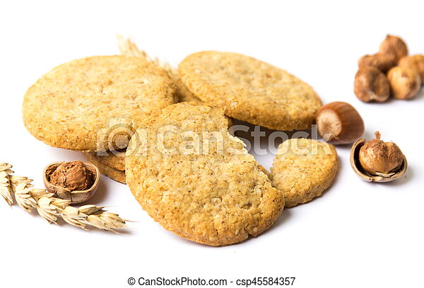 Integral cookies with hazelnuts and linseed on white - csp45584357