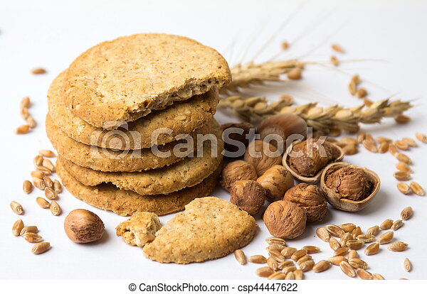 Integral cookies with hazelnuts and linseed on white - csp44447622