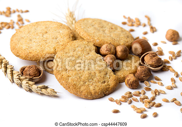 Integral cookies with hazelnuts and linseed on white - csp44447609