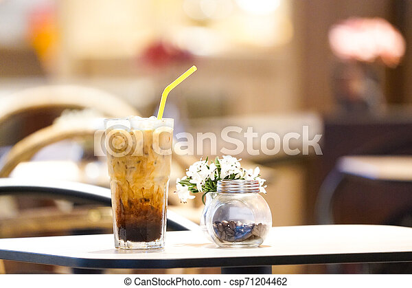 Intense Coffee on the wood table. - csp71204462
