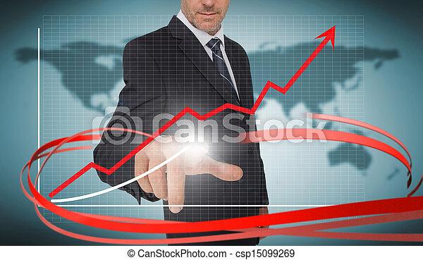 Hombre de negocios tocando gráficos de crecimiento en interfaz futurista con flechas rojas en el mapa del mundo - csp15099269