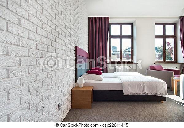 Interior de dormitorio brillante - csp22641415
