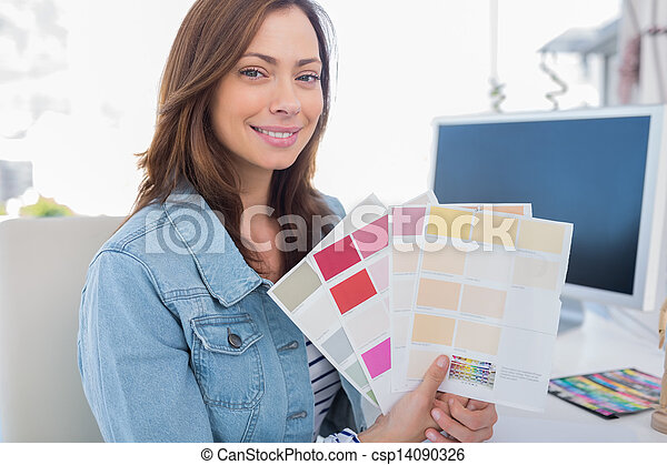 Interior designer holding up colour samples - csp14090326
