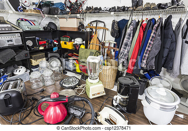 Interior garage sale, housewares, clothing, slorting goods and toys. - csp12378471