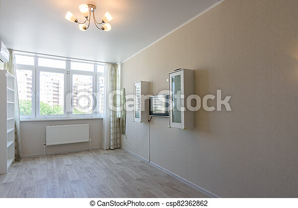 Interior of a bedroom in an apartment - csp82362862