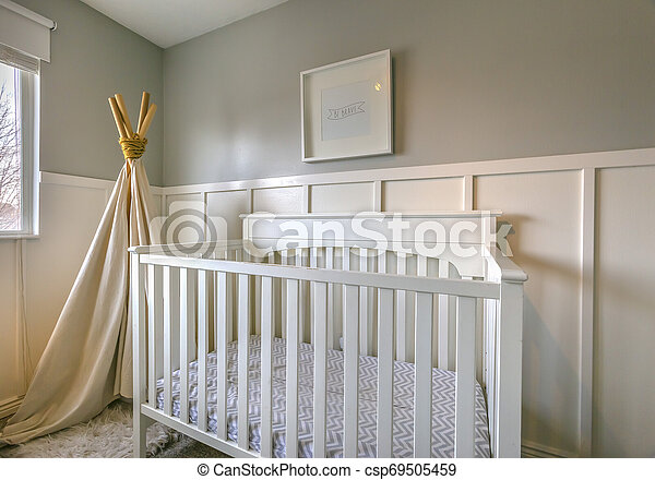Interior of a room for children with white wooden crib and play teepee - csp69505459