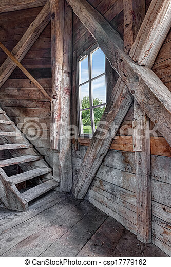 Interior Of An Abandoned Wooden House With Staircase And View Over Green Garden