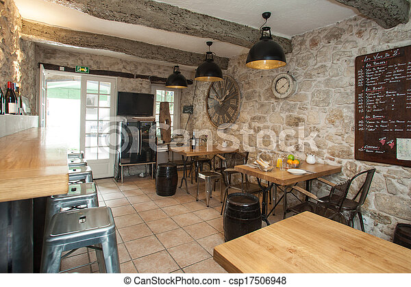 Interior of French bistro with rustic furniture. - csp17506948