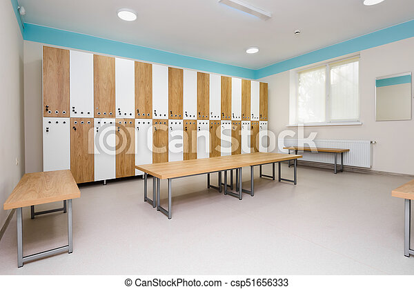 Interior of gym locker room brown blue and white colored