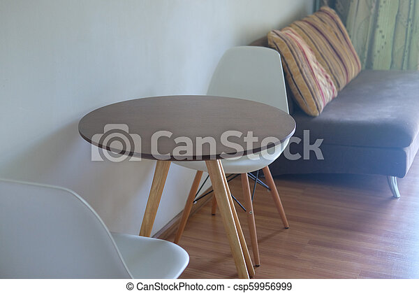 Interior of modern apartment with sofa and chair