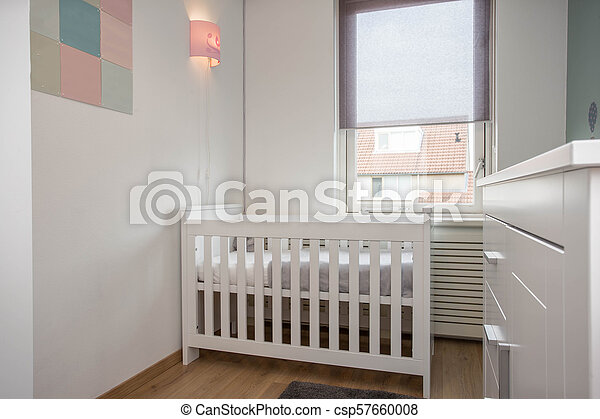 Interior of modern baby room simple white decoration - csp57660008