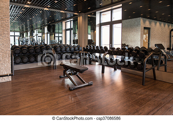Interior of new modern gym with equipment equipment and machines