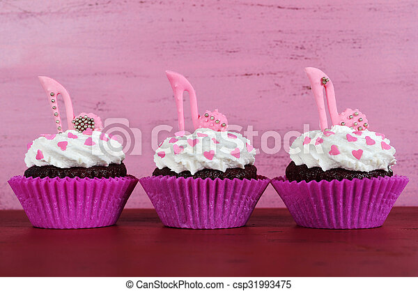 International Womens Day March 8 Cupcakes With High Heel Stiletto Fondant Shoes On Vintage Pink Wood Background
