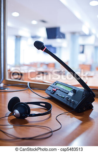 interpreting - Microphone and switchboard in an simultaneous interpreter booth - csp5483513