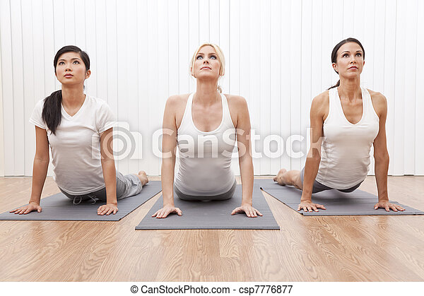 Interracial Group of Three Beautiful Women In Yoga Position - csp7776877