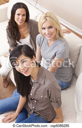 Interracial Group of Three Beautiful Women Friends Smiling - csp6086285