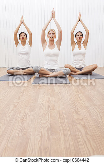 Interracial Group of Three Beautiful Women In Yoga Position - csp10664442