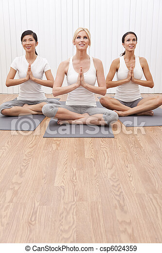 Interracial Group of Three Beautiful Women In Yoga Position - csp6024359