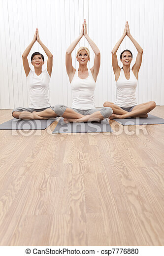 Interracial Group of Three Beautiful Women In Yoga Position - csp7776880