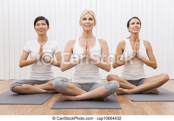 Interracial Group of Three Beautiful Women In Yoga Position - csp10664432