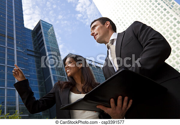 Interracial Male and Female Business Team In Modern City - csp3391577