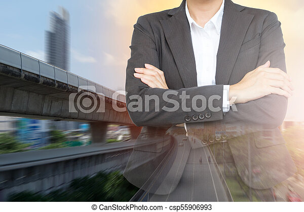 Investment in transportation concept. Business woman with Sky train background. - csp55906993