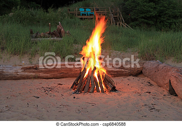 Inviting campfire on the beach - csp6840588