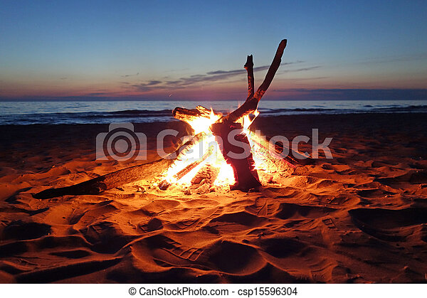Inviting campfire on the beach - csp15596304