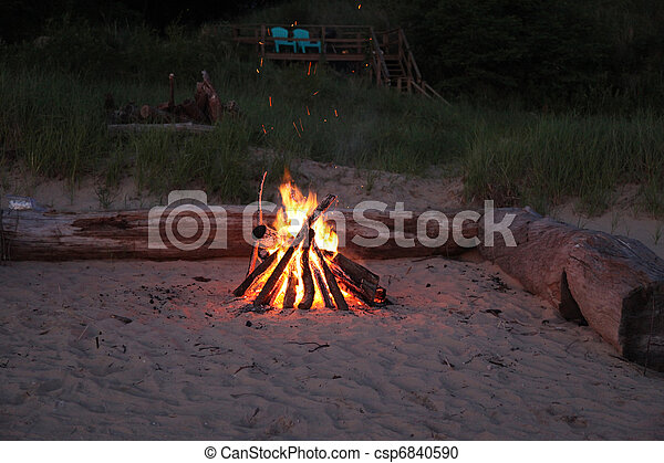Inviting campfire on the beach - csp6840590