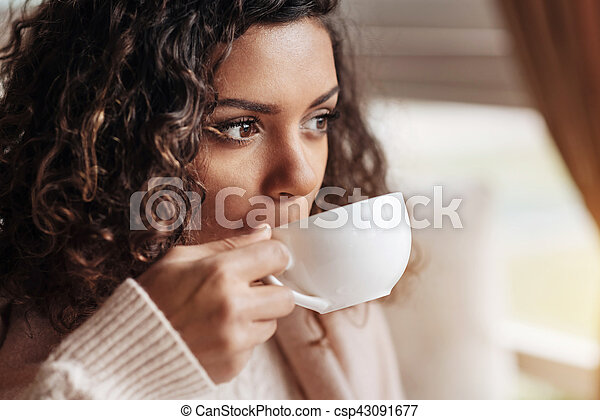 Involved African American woman drinking the cup of tea - csp43091677
