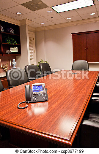 An Ip Phone On A Conference Room Table In A Meeting Room